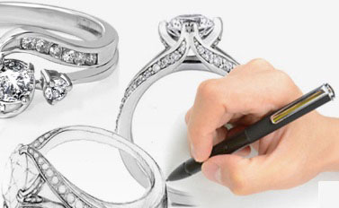 a jeweler designing and drawing a ring